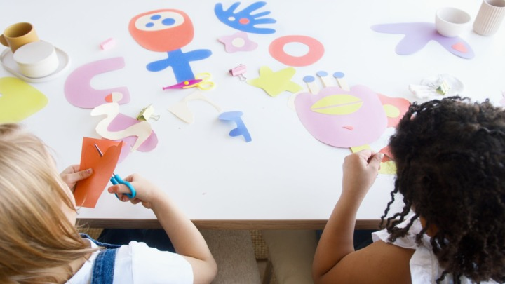 two kids doing some artworks
